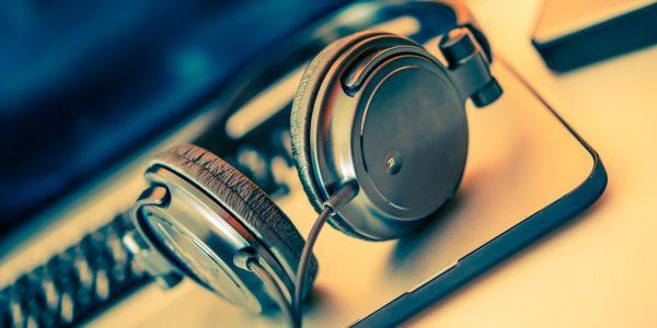 Headphones on Laptop Computer. Online Music Listening. Music Concept.